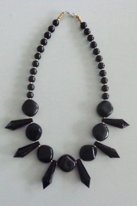 Black necklace with a white rose